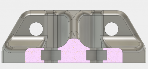 The nuts will be embedded just before the top cavity layer prints.