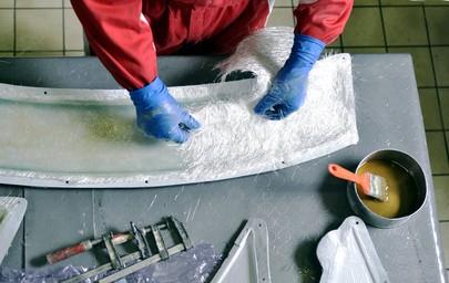 a fiberglass layup within a mold