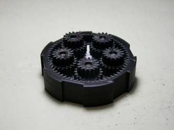 The 3D printed mechanism allows for rapid energy storage and transfer between two coaxial systems.