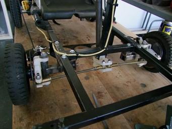 Fiber-reinforced 3D printed steering knuckles on a go-kart.