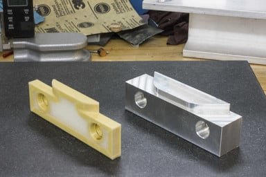 Kevlar Reinforced Soft Jaw next to Aluminum Jaw