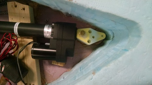 The bracket is holding the linear actuator in place and securing it to the deck.
